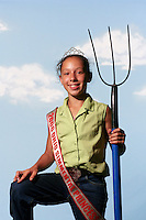 (7 FairKids Joy Falkenberg 08.03.06)  Abby Ames (cq) 12 poses at The Ohio State Fair.  She is from London, Ohio and is the 2006 Ohio Simmental (cq)Princess.  She was wearing her crown and sash on this day.  The pitch fork was not hers.  Simmental is the name of a specific beef cow.  Photo to go with NOW! package on kids at the Fair.  (Columbus Dispatch Photo by Barth Falkenberg)