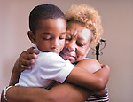 """First grader, Christian Price, 7, of Waldorf gives a good-bye hug to school secretary and mother figure """"Grandma"""" Audrey Watkins of Capitol Heights during the final awards ceremony and assembly of St. Margaret of Scotland Catholic School in Seat Pleasant. The school is closing after 50 years of operation and """"Grandma"""" Watkins has been at the school for 21 years."""