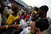 Ghanaians buy anniversary T shirts  while awaiting for the 50th anniversary of their countries' independence in the main market of  Accra, Ghana on Monday March 05 2007..