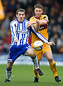 KILMARNOCK'S PAUL HEFFERNAN IS CHALLENGED BY MOTHERWELL'S STEPHEN CRAIGAN