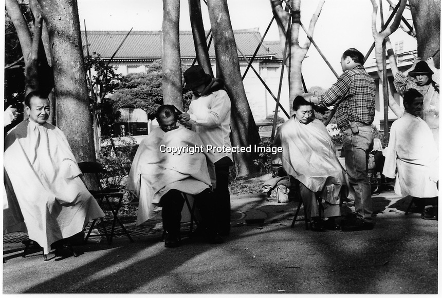 Former Yakuza, Japanese gangstars became Christian missionaries having free haircut service to homeless people at Ueno Park, Tokyo Japan