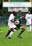 13 September 2009: University of Vermont Catamount forward/midfielder T.J. Gore (7), a Senior from Macomb, MI, battles University of Massachusetts Minutemen forward Chris Roswess (11), a Sophomore from West Springfield, MA, during the second round of the 2009 Morgan Stanley Smith Barney Soccer Classic held at Centennial Field in Burlington, Vermont. The Catamounts and Minutemen battled to a 1-1 double-overtime tie. Mandatory Photo Credit: Ed Wolfstein Photo