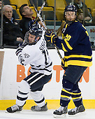 Mike Sislo (UNH - 19), Ryan Flanigan (Merrimack - 20) - The Merrimack College Warriors defeated the University of New Hampshire Wildcats 4-1 in their Hockey East Semi-Final on Friday, March 18, 2011, at TD Garden in Boston, Massachusetts.