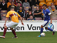 Tim Cahill being watched by Simon Ramsden in the Motherwell v Everton friendly match at Fir Park, Motherwell on 21.7.12 for Steven Hammell's Testimonial.