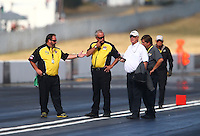 Aug. 4, 2013; Kent, WA, USA: NHRA officials meet with Graham Light (white shirt) on the track during the Northwest Nationals at Pacific Raceways. Mandatory Credit: Mark J. Rebilas-USA TODAY Sports
