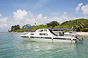 A tour boat docked at Turtle Islands National Park (Taman Negara Pulau Penyuh). Visitors come to learn about Sea Turtles and have a chance to watch them lay their eggs on shore at night. Sabah, Malaysia
