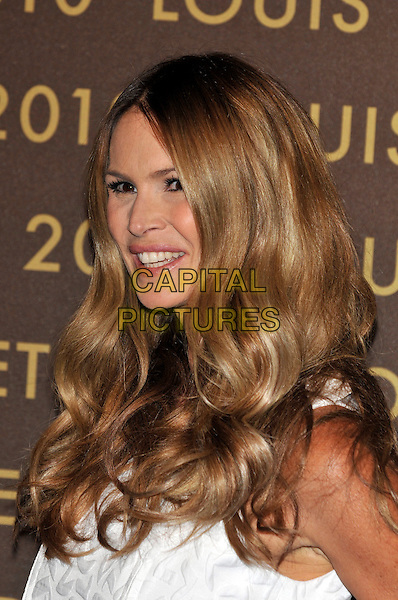 ELLE MACPHERSON .attends the launch of the Louis Vuitton Bond Street Maison Store in London, England, UK, May 25th, 2010. .portrait headshot white long wavy hair profile smiling .CAP/PL.©Phil Loftus/Capital Pictures.