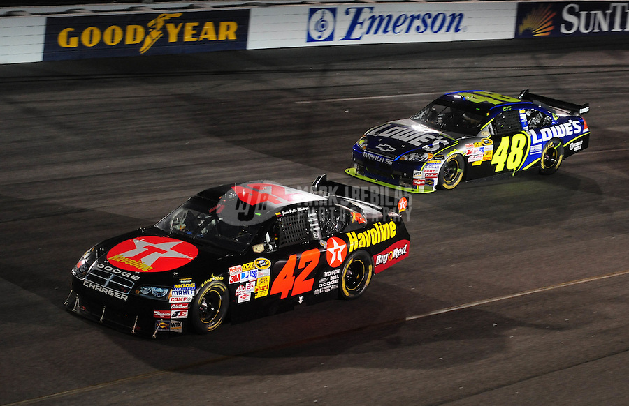 May 3, 2008; Richmond, VA, USA; NASCAR Sprint Cup Series driver Juan Pablo Montoya (42) leads Jimmie Johnson (48) during the Dan Lowry 400 at the Richmond International Raceway. Mandatory Credit: Mark J. Rebilas-US PRESSWIRE