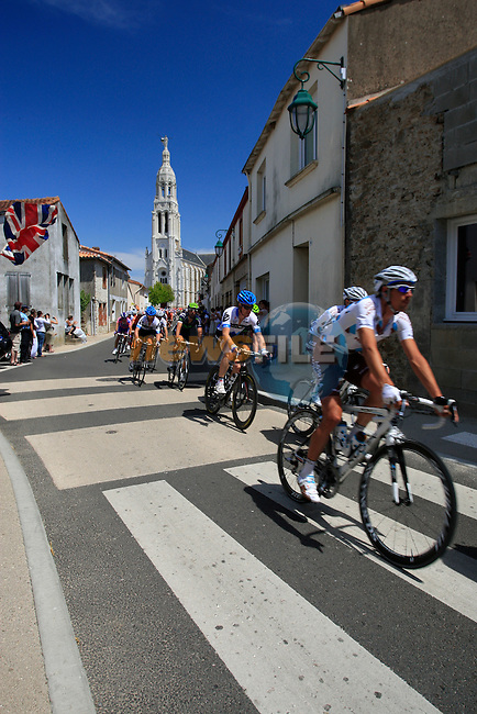 The pelethon pass through the town of Saint-Lumine-de-Coutais during the 3rd Stage of the 2011 Tour de France, 198k from Olonne-sur-Mere to Redon, 4th July 2011 (Photo by Eoin Clarke/NEWSFILE)