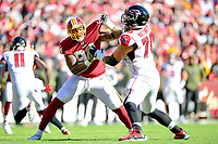 Landover, MD - November 4, 2018: Washington Redskins outside linebacker Preston Smith (94) fights off of a block by Atlanta Falcons offensive tackle Matt Gono (77) during game between the Atlanta Falcons and the Washington Redskins at FedEx Field in Landover, MD. The Falcons defeated the Redskins 38-13. (Photo by Phillip Peters/Media Images International)
