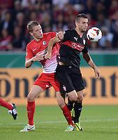 FUSSBALL   DFB POKAL 2. RUNDE   SAISON 2013/2014 SC Freiburg - VfB Stuttgart      25.09.2013 Vedad Ibisevic (re,  VfB Stuttgart) gegen Matthias Ginther (SC Freiburg)