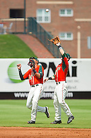 Greensboro Grasshoppers shortstop Rehiner Cordova (1) almost collides with second baseman Blake Barber (8) as he settles under a pop fly during the South Atlantic League game against the Augusta GreenJackets at NewBridge Bank Park on August 11, 2013 in Greensboro, North Carolina.  The GreenJackets defeated the Grasshoppers 6-5 in game one of a double-header.  (Brian Westerholt/Four Seam Images)