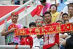 10 August 2008: Unidentified China fans.  China played in the second game of the night against Belgium.  The men's Olympic soccer team of Belgium defeated the men's Olympic soccer team of China 2-0 at Shenyang Olympic Sports Center Wulihe Stadium in Shenyang, China in a Group C round-robin match in the Men's Olympic Football competition.