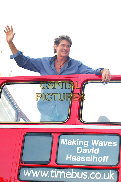 "DAVID HASSELHOFF.personal apperances to promote his autobiography ""Making Waves"" .on double decker red London bus.London England 17th September 2006.Ref: DAR.book half length waving.www.capitalpictures.com.sales@capitalpictures.com.©Darwin/Capital Pictures"