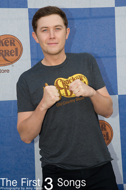 Scotty McCreery attends the Cracker Barrel Old Country Store Country Checkers Challenge at Globe Life Park in Arlington on April 18, 2015 in Arlington, Texas