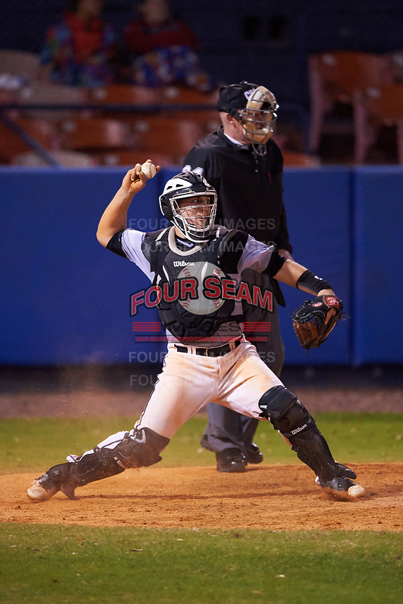 Wisconsin-Milwaukee Panthers catcher Daulton Varsho (10) throws down in front of umpire Jeff Gould during a game against the Ball State Cardinals on February 26, 2016 at Chain of Lakes Stadium in Winter Haven, Florida.  Ball State defeated Wisconsin-Milwaukee 11-5.  (Mike Janes/Four Seam Images)