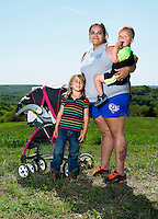 Angie Almendarez (cq), Braydan Almendarez (cq, age 2) and Ariana Almendarez (cq, age 5), from Hollister, Missouri, at the U.S. Open Bowfishing Championship, Saturday, May 3, 2014. <br /> <br /> Photo by Matt Nager