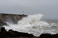 Pictured: Waves hit Porthcawl lighthouse in  Bridgend, Wales, UK. Wednesday 19 September 2018