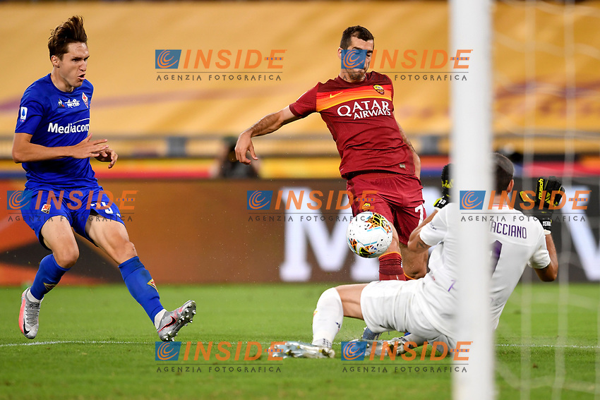 Federico Chiesa of ACF Fiorentina , Henrikh Mkhitaryan of AS Roma and Pietro Terracciano of ACF Fiorentina in action during the Serie A football match between AS Roma and ACF Fiorentina at stadio Olimpico in Roma (Italy), July 26th, 2020. Play resumes behind closed doors following the outbreak of the coronavirus disease. <br /> Photo Antonietta Baldassarre / Insidefoto