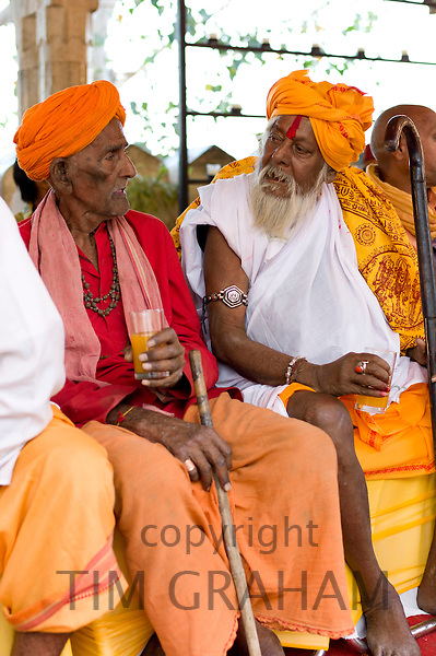 Hindu priests at Holi festival of 76th Maharana of Mewar, at the City Palace, Udaipur, Rajasthan, India