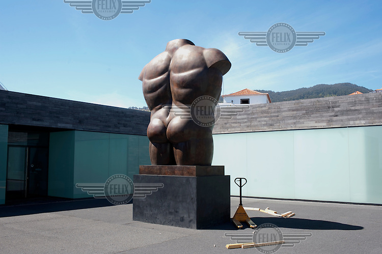 'Male Torso' 1992, a sculpture by Fernando Botero, at the Casa Das Mundos Art Gallery in Calheta.