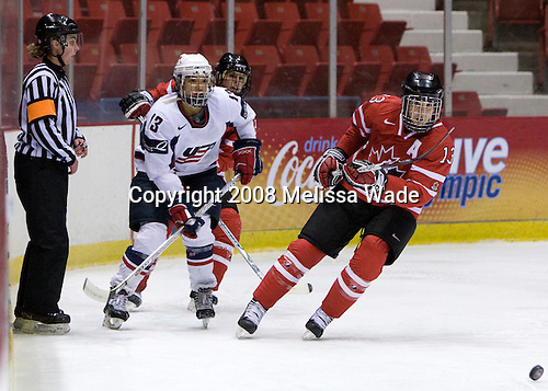 Julie Chu (US - 13), ?, Caroline Ouellette (Canada - 13) - Team USA defeated Team Canada 4-3 (so) to win the 2008 Four Nations Cup on Sunday, November 9, 2008, in the 1980 Rink in Lake Placid, New York.