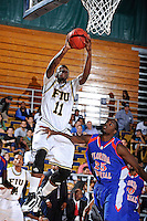 12 November 2010:  FIU's Marvin Roberts (11) shoots over Florida Memorial's Mark Rolle (25) in the second half as the FIU Golden Panthers defeated the Florida Memorial Lions, 89-73, at the U.S. Century Bank Arena in Miami, Florida.