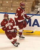 Matt Van Voorhis (DU - 6), Nick Neville (DU - 2) - The Boston College Eagles defeated the University of Denver Pioneers 6-2 in their NCAA Northeast Regional semi-final on Saturday, March 29, 2014, at the DCU Center in Worcester, Massachusetts.
