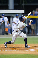 Oscar Rojas (13) of the Princeton Rays follows through on his swing against the Burlington Royals at Burlington Athletic Stadium on August 12, 2016 in Burlington, North Carolina.  The Royals defeated the Rays 9-5.  (Brian Westerholt/Four Seam Images)