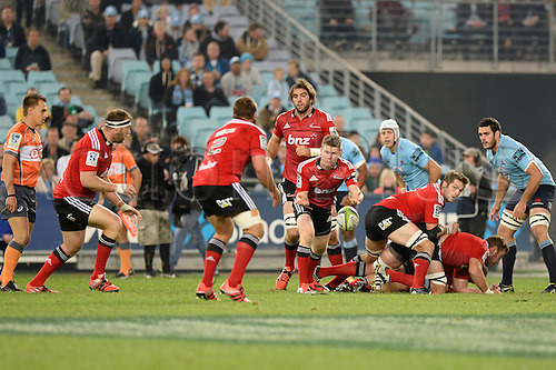 23.05.2015.  Sydney, Australia. Super Rugby. NSW Waratahs versus the Crusaders. Crusaders scrum half Mitchell Drummond plays the ball along his line. The Waratahs won 32-22.