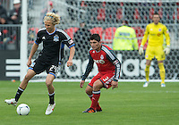 24 March 2012: San Jose Earthquakes forward Steven Lenhart #24 and Toronto FC defender Miguel Aceval #3 in action during the second half in a game between the San Jose Earthquakes and Toronto FC at BMO Field in Toronto..The San Jose Earthquakes won 3-0..