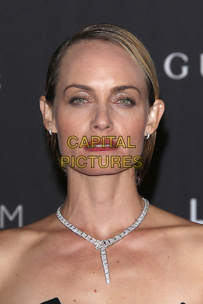 LOS ANGELES, CA - NOVEMBER 7: Amber Valletta at the LACMA Art + Film Gala honoring Alejandro G. I&ntilde;&aacute;rritu and James Turrell and presented by Gucci at LACMA on November 7, 2015 in Los Angeles, California. <br /> CAP/MPI27<br /> &copy;MPI27/Capital Pictures