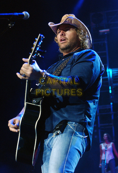 "TOBY KEITH .Performs llive in concert during his ""Big Throwdown Tour II"" at the Post-Gazette Pavilion, Pittsburgh, PA, USA, July 2, 2005..half length gig country music guitar cowboy hat.Ref: ADM.www.capitalpictures.com.sales@capitalpictures.com.©AdMedia/Capital Pictures."