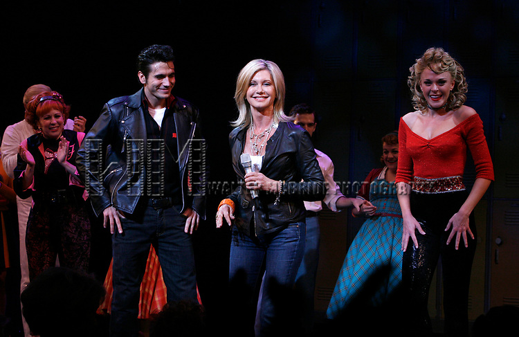 Olivia Newton-John is headed back to Rydell High to promote Breast Cancer Awareness after the Curtain Call for GREASE at the Brooks Atkinsoon Yheatre in New York City. <br />October 7, 2008<br />( pictured: Olivia Newton John, Derek Keeling, Ashley Spencer )