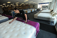 NWA Democrat-Gazette/ANDY SHUPE<br /> Josh Nescott, assistant manager for Joplimo Mattress, shows a ForeverBed Thursday, Aug. 6, 2015, in the newly opened store located in the shopping center it shares with Whole Foods.