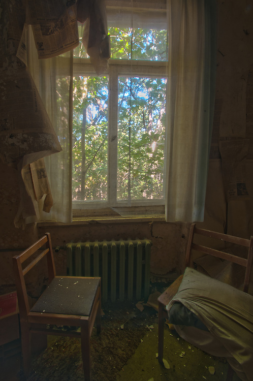 Small room interior with chairs in Krampnitz, an old tank barracks
