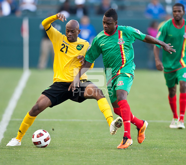 CARSON, CA – June 6, 2011: Jamaican Luton Shelton (21) and Greneda player Lancaster Joseph (16) battle for the ball during the match between Grenada and Jamaica at the Home Depot Center in Carson, California. Final score Jamaica 4 and Grenada 0.