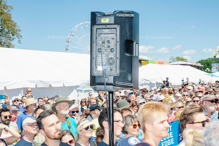 People listen as South Bend mayor and Democratic presidential candidate Pete Buttigieg speaks at the Political Soapbox at the Iowa State Fair in Des Moines, Iowa, on Tues., Aug. 13, 2019.