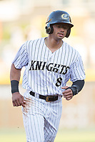 Jacob May (8) of the Charlotte Knights rounds third base during the game against the Durham Bulls at BB&T BallPark on May 15, 2017 in Charlotte, North Carolina. The Knights defeated the Bulls 6-4.  (Brian Westerholt/Four Seam Images)