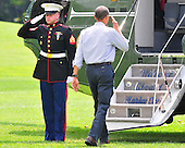 United States President Barack Obama salutes the Marine Guard as he boards Marine 1 to begin his summer vacation on the South Lawn of the White House in Washington, D.C. in Martha's Vineyard on Thursday, August 19, 2010..Credit: Ron Sachs / Pool via CNP