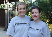 NWA Democrat-Gazette/CARIN SCHOPPMEYER Mackenzie Ruebling (left) and Kayla Kilmer, University of Arkansas Hospitality Club members, volunteer at Chefs in the Garden.