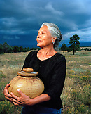 USA, New Mexico, beautiful Native American woman holding a pot, Valley of the Wild Roses