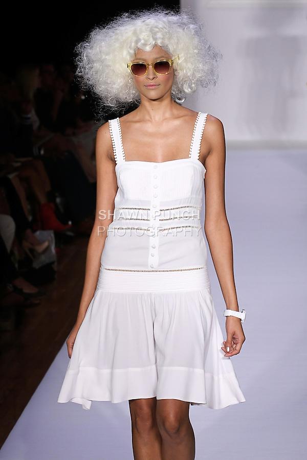 Karen walks runway in an alabaster silk crepe Blythe dress, and Sally white nubuck vintage bootie, for the bebe BLACK Spring 2012 collection fashon show, during Elle Stlye 360 Spring 2012 Fashion Week.