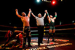 Lucha Libre AAA wrestlers Joe Lider and Jack Evans are the victors at a match in Sacramento, CA March 28, 2009.