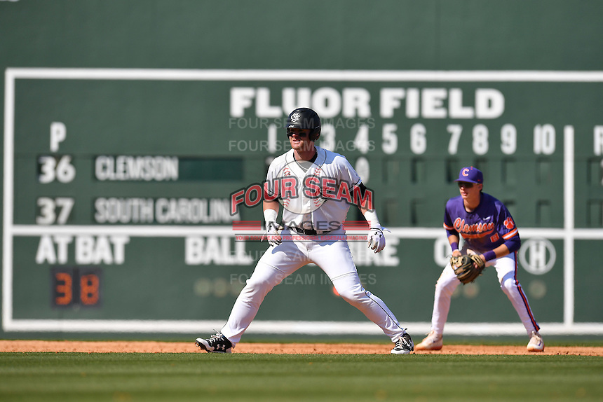 Designated hitter Alex Destino (24) of the South Carolina Gamecocks hits in the Reedy River Rivalry game against the Clemson Tigers on Saturday, March 4, 2017, at Fluor Field at the West End in Greenville, South Carolina. Clemson won, 8-7. (Tom Priddy/Four Seam Images)