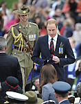 AUSTRALIA, Canberra : Britains Prince William returns to his seat after giving a speech at the ANZAC service, Canberra on April 25, 2014. Britain's Prince William, his wife Kate and their son Prince George were on a three-week tour of New Zealand and Australia. AFP PHOTO / Mark GRAHAM