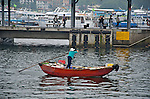Sai Kung  A woman rows her fish to market in the harbor of Sai Kung.