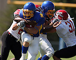 MADISON, SD - AUGUST 30: Andrew Fatten of Dakota State University is brought down by Edward James of Bacone College in the first quarter of their game Saturday afternoon at Trojan Field in Madison. (photo by Dave Eggen/Inertia)