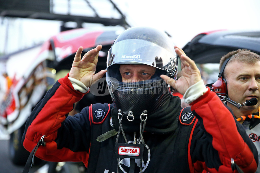 Apr 24, 2015; Baytown, TX, USA; NHRA funny car driver Chad Head puts on his safety equipment during qualifying for the Spring Nationals at Royal Purple Raceway. Mandatory Credit: Mark J. Rebilas-