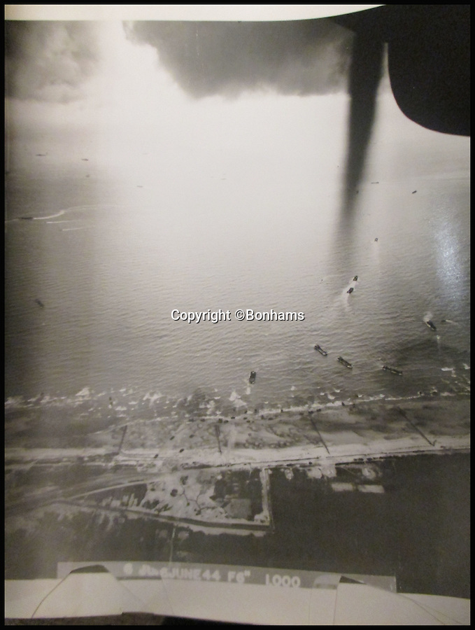 BNPS.co.uk (01202 558833)<br /> Pic: Bonhams/BNPS<br /> <br /> Juno or Gold beach on D-day.<br /> <br /> A collection of aerial photographs of the D-Day landings.<br /> <br /> Incredible never-seen-before aerial photographs of the D-Day landings revealing the sheer scale of the historic mission have come to light for the first time in 71 years.<br /> <br /> The grainy black and white images were taken from one of just three spy planes sent up to document the mass invasion of Normandy's beaches on June 6, 1944.<br /> <br /> The top secret shots were then taken back to Allied commanders in Britain so they could see how the mission, codenamed Overlord, was unfolding.<br /> <br /> A set of more than 120 unseen prints taken by Victor B. Gras, a US photographer with the 13th Photographic Reconnaissance Squadron, have come to light after they were listed for auction.<br /> <br /> The poignant photographs, which have never been seen outside of the military before, are thought to be of the British/Canadian beaches of Gold and Juno.<br /> <br /> They were discovered in a file compiled by Gras as a memento of his experiences during the war.